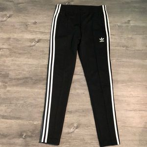 Black Adidas joggers with white stripes